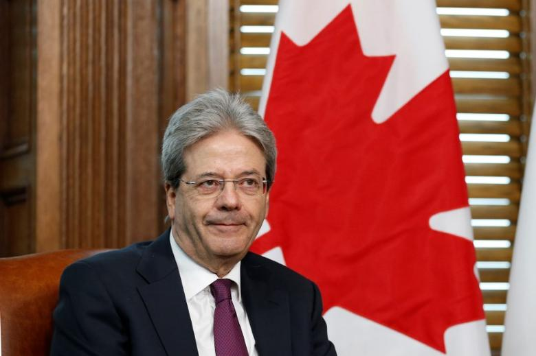 FILE PHOTO: Italy's Prime Minister Paolo Gentiloni takes part in a meeting with Canada's Prime Minister Justin Trudeau in Trudeau's office on Parliament Hill in Ottawa, Ontario, Canada, April 21, 2017. REUTERS/Chris Wattie