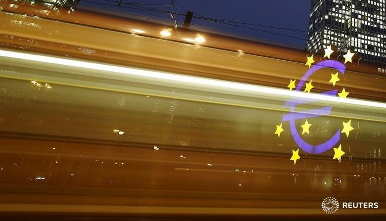 FILE PHOTO - The famous euro sign landmark is seen through the lights of a passing tram outside the former headquarters of the European Central Bank (ECB) in Frankfurt, Germany, January 19, 2016.    REUTERS/Kai Pfaffenbach