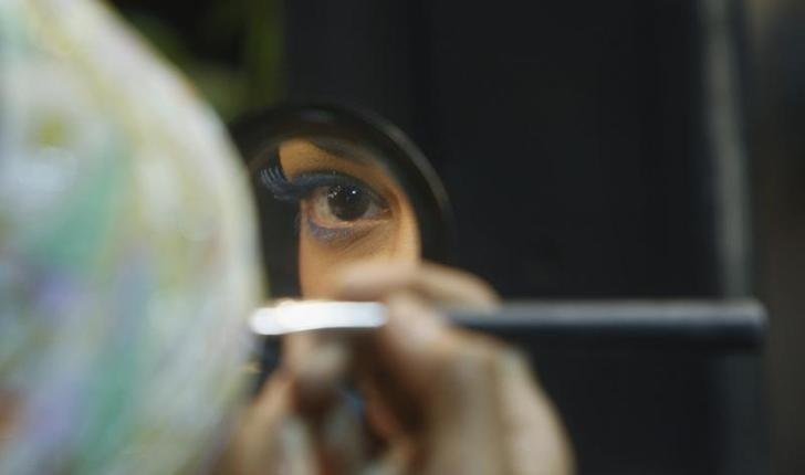 REPRESENTATIVE IMAGE: A model applies make-up backstage before the start of a fashion show in New Delhi March 22, 2009. REUTERS/Adnan Abidi/Files