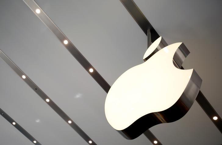 The Apple logo is pictured inside the newly opened Omotesando Apple store at a shopping district in Tokyo June 26, 2014. REUTERS/Yuya Shino/File Photo
