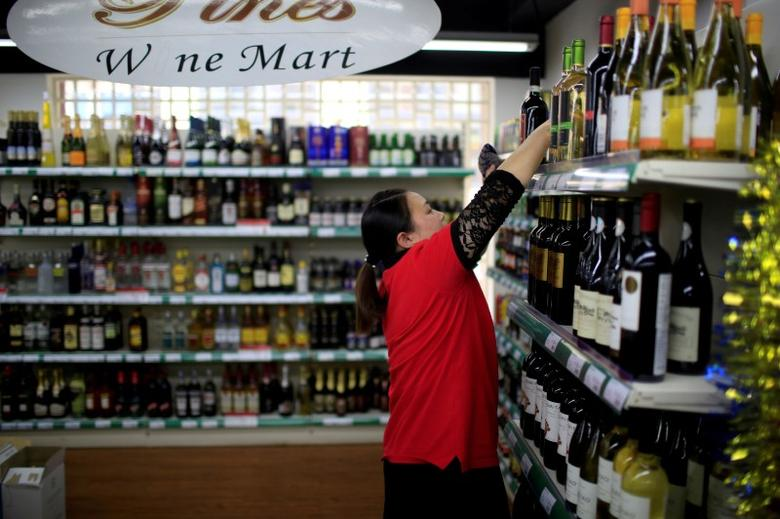 A staff member checks bottles of wine at a mart in Shanghai, China, June 2, 2016. REUTERS/Aly Song/File Photo