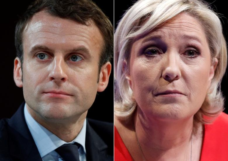 A combination picture shows portraits of the candidates who will run in the second round in the 2017 French presidential election, Emmanuel Macron (L), head of the political movement En Marche !, or Onwards !, and Marine Le Pen, French National Front (FN) political party leader.  Pictures taken March 11, 2017 (R) and February 21, 2017 (L).  REUTERS/Christian Hartmann
