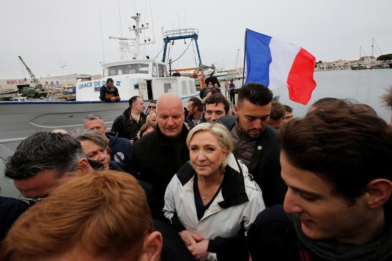 Marine Le Pen (C), French National Front (FN) political party candidate for French 2017 presidential election, leaves a fishing boat after a campaign visit to the port in Grau-du-Roi, France, April 27, 2017.  REUTERS/Jean-Paul Pelissier