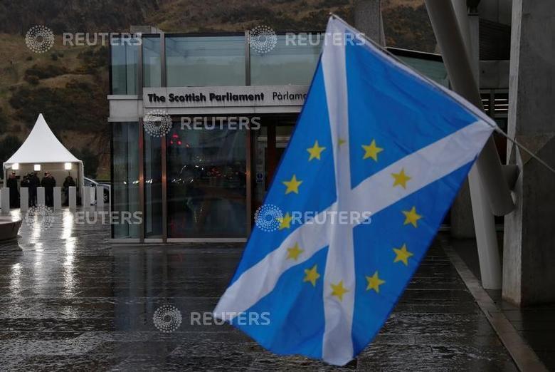 A Scottish Saltire flag flies outside the Scottish Parliament following suspension of the referendum debate in Edinburgh, Scotland, Britain March 22, 2017. REUTERS/Russell Cheyne