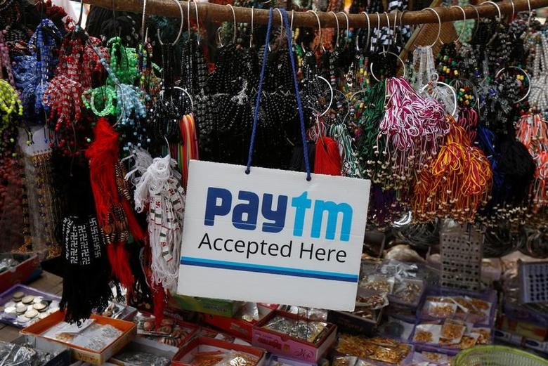 An advertisement of Paytm, a digital wallet company, is pictured at a road side stall in Kolkata, India, January 25, 2017. REUTERS/Rupak De Chowdhuri/Files