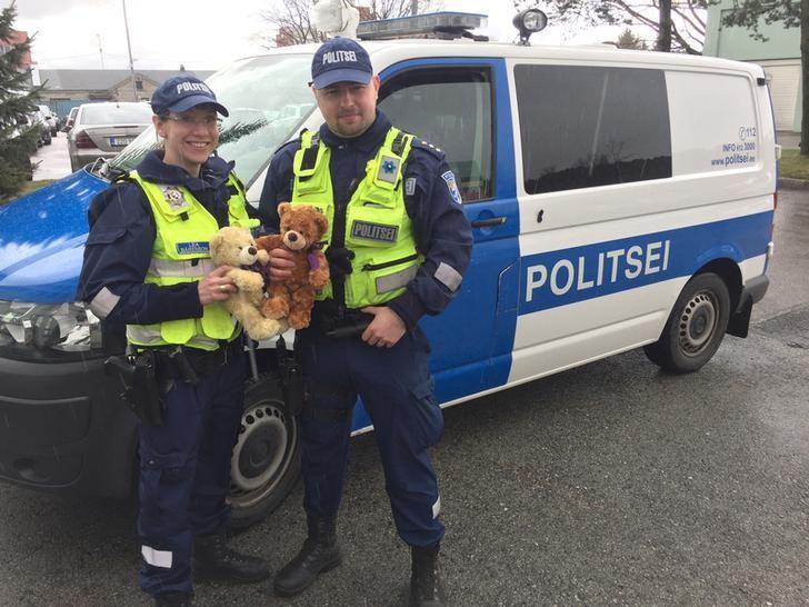 Estonian police officers pose with Teddy beard in Tallinn, Estonia, April 26, 2017. REUTERS/Janis Laizans
