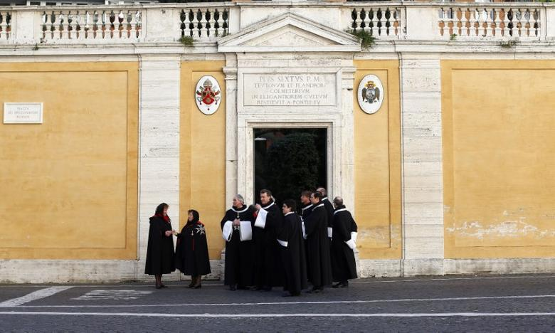 FILE PHOTO: Members of the Order of the Knights of Malta arrive in St. Peter Basilica for their 900th anniversary in Vatican February 9, 2013. REUTERS/Alessandro Bianchi