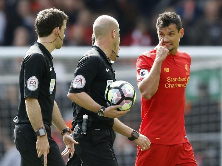 Britain Soccer Football - Liverpool v Everton - Premier League - Anfield - 1/4/17 Liverpool's Dejan Lovren speaks to referee Anthony Taylor at half time  Action Images via Reuters / Carl Recine