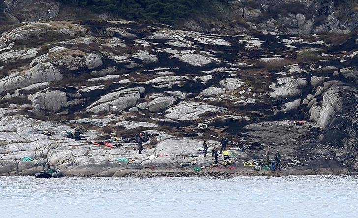 Bergen, 20160430:  Police and rescue workers at the place where a helicopter crashed on April 29th on the island Turoy otside of Bergen. 13 people were killed in the accident. NTB Scanpix/Vidar Ruud/via REUTERS/Files