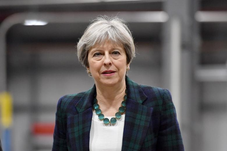 Britain's Prime Minister Theresa May visits IKO Polymetric in Chesterfield, April 27, 2017.  REUTERS/Anthony Devlin/Pool/Files