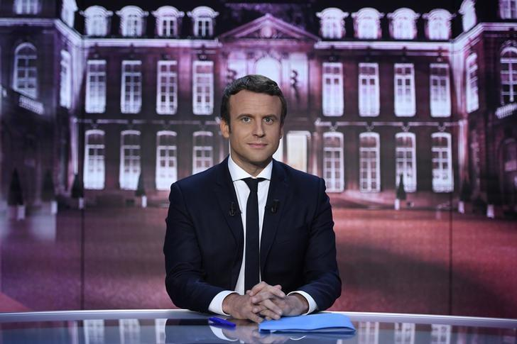 Emmanuel Macron, head of the political movement En Marche !, or Onwards !, and candidate for the 2017 presidential election, poses before taking part in the show ''Elysee 2017'' on French television channel TF1 in Paris, France,  April 27, 2017.  REUTERS/Eric Feferberg/Pool