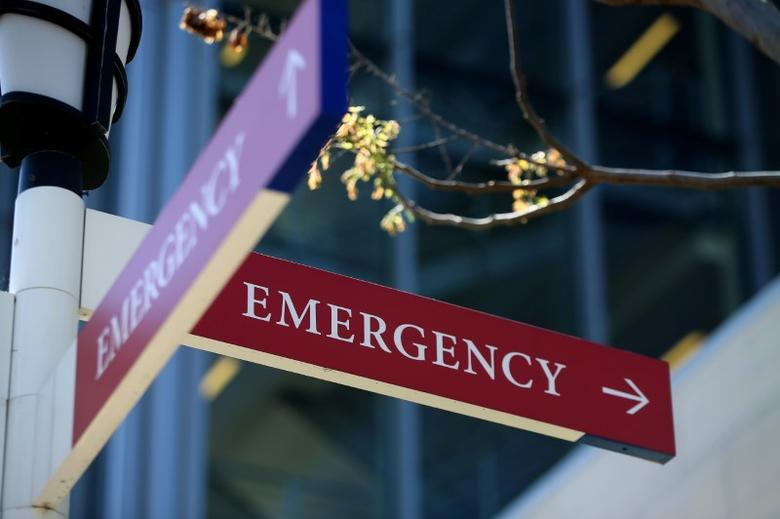 A sidewalk sign points to the emergency entrance at the University of San Diego Health System in La Jolla, California, U.S., March 23, 2017.    REUTERS/Mike Blake