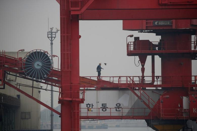 An employee walks on a crane at a container terminal at Incheon port in Incheon, South Korea, May 26, 2016.  REUTERS/Kim Hong-Ji/File Photo