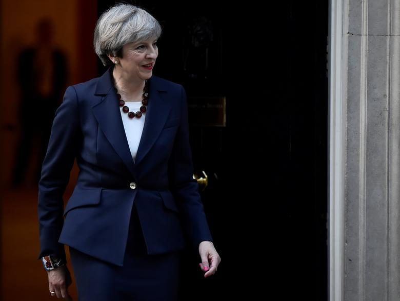 Britain's Prime Minister Theresa May walks out of 10 Downing Street to welcome Head of the European Commission, President Jean-Claude Juncker to Downing Street in London, Britain April 26, 2017. REUTERS/Hannah McKay