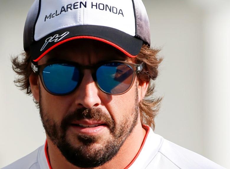 FILE PHOTO - Formula One - Japanese Grand Prix - Suzuka Circuit, Japan- 6/10/16. McLaren's Fernando Alonso of Spain walks in the paddock to attend a news conference.    REUTERS/Toru Hanai/File Photo