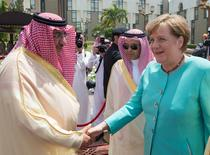 Saudi Crown Prince Mohammed Bin Nayef shakes hands with German Chancellor Angela Merkel during a reception ceremony in Jeddah, Saudi Arabia April 30, 2017. Bandar Algaloud/Courtesy of Saudi Royal Court/Handout via REUTERS