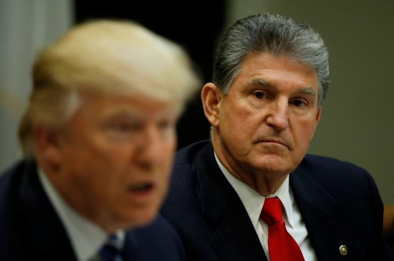 West Virginia Democrat Sen. Joe Manchin (R), who broke ranks to vote with Republicans for Jeff Sessions to become U.S. Attorney General, looks towards U.S President Donald Trump during a Supreme Court listening session at the White House in Washington, U.S., February 9, 2017.  REUTERS/Kevin Lamarque
