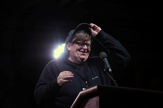 Michael Moore speaks at a protest against U.S. President Donald Trump outside the Trump International Hotel in New York City, U.S. January 19, 2017. REUTERS/Stephanie Keith