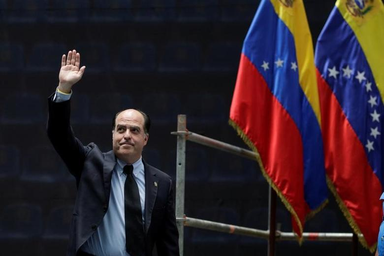 Julio Borges, President of the National Assembly, waves as he arrives for a National Assembly session at the Parque Miranda sports center in Caracas, Venezuela April 27, 2017. REUTERS/Marco Bello