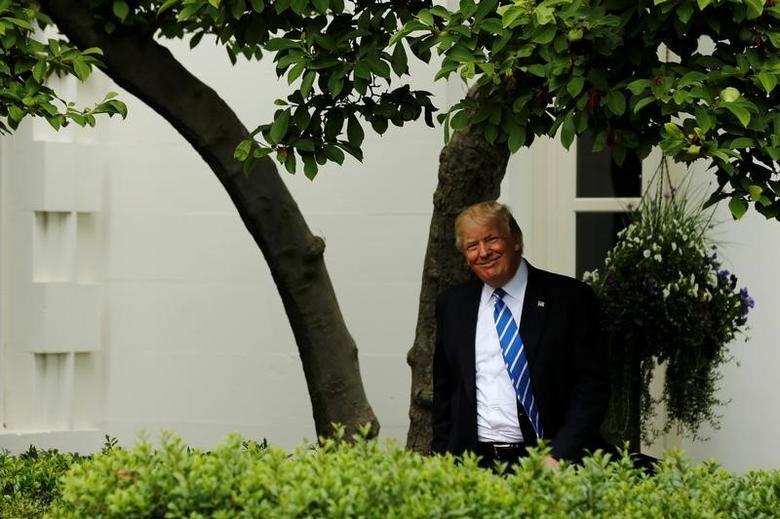 U.S. President Donald Trump arrives to deliver remarks to members of the Independent Community Bankers Association in the Kennedy Garden at the White House in Washington, U.S., May 1, 2017.  REUTERS/Jonathan Ernst