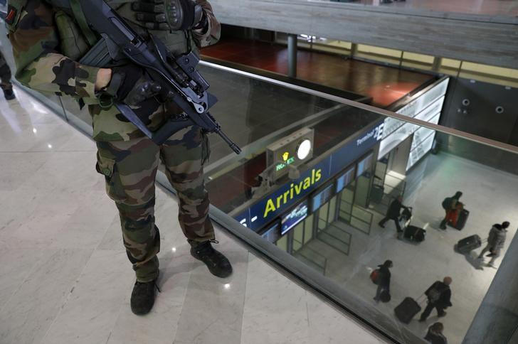 A French soldier patrols inside the Charles de Gaulle International Airport in Roissy, near Paris, France, March 23, 2016.   REUTERS/Philippe Wojazer/Files