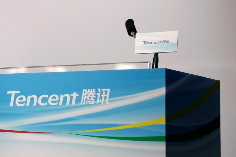 Logos of Tencent are displayed at a news conference in Hong Kong, China March 22, 2017. REUTERS/Tyrone Siu