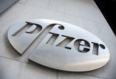FILE PHOTO: The Pfizer logo is seen at their world headquarters in New York April 28, 2014.  REUTERS/Andrew Kelly/File Photo