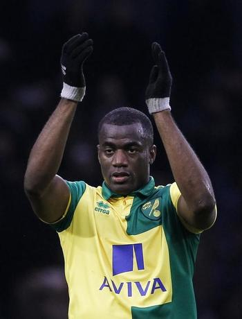 Football Soccer - West Bromwich Albion v Norwich City - Barclays Premier League - The Hawthorns - 15/16 - 19/3/16Norwich City's Sebastien Bassong applauds fans after victory Mandatory Credit: Action Images / Craig Brough/FilesEDITORIAL USE ONLY. No use with unauthorized audio, video, data, fixture lists, club/league logos or ''live'' services. Online in-match use limited to 45 images, no video emulation. No use in betting, games or single club/league/player publications.  Please contact your account representative for further details.