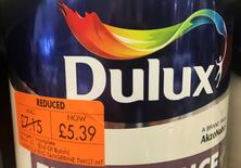 Cans of Dulux paint, an Akzo Nobel brand, are seen on the shelves of a hardware store near Manchester, Britain, April 24, 2017. REUTERS/Phil Noble