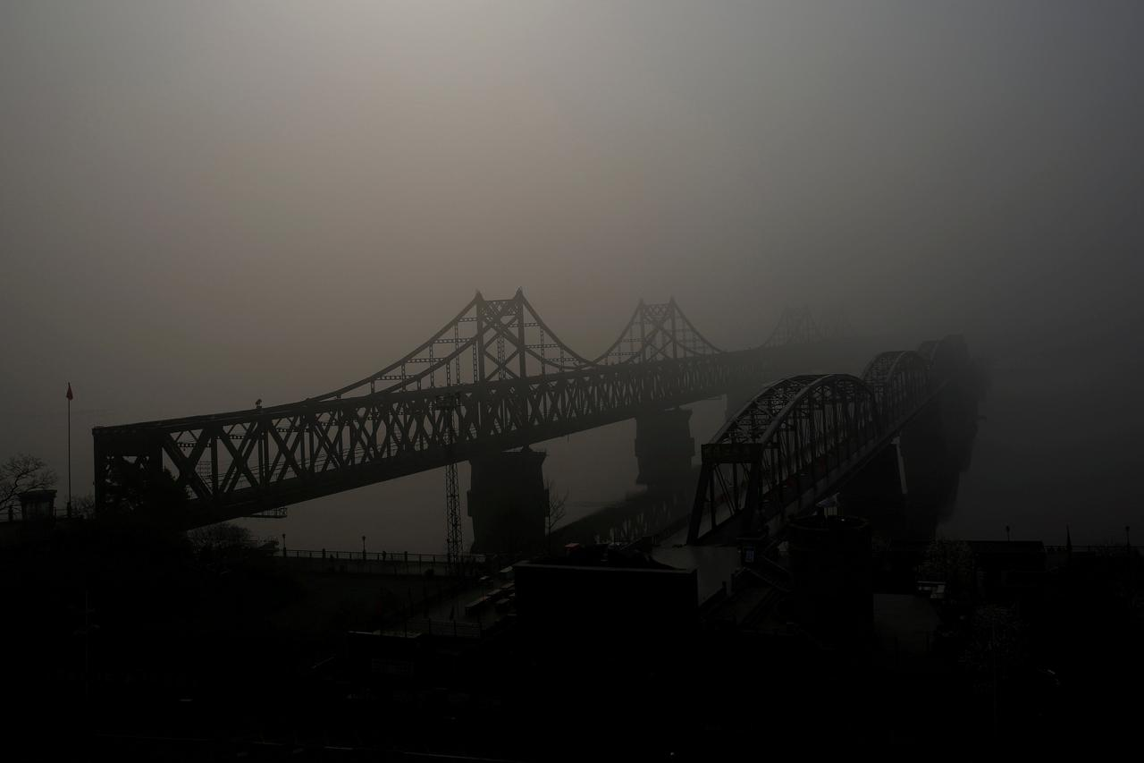 FILE PHOTO: The Friendship and the Broken bridges over the Yalu River  connecting the North Korean town of Sinuiju and Dandong in China's Liaoning  province, ...