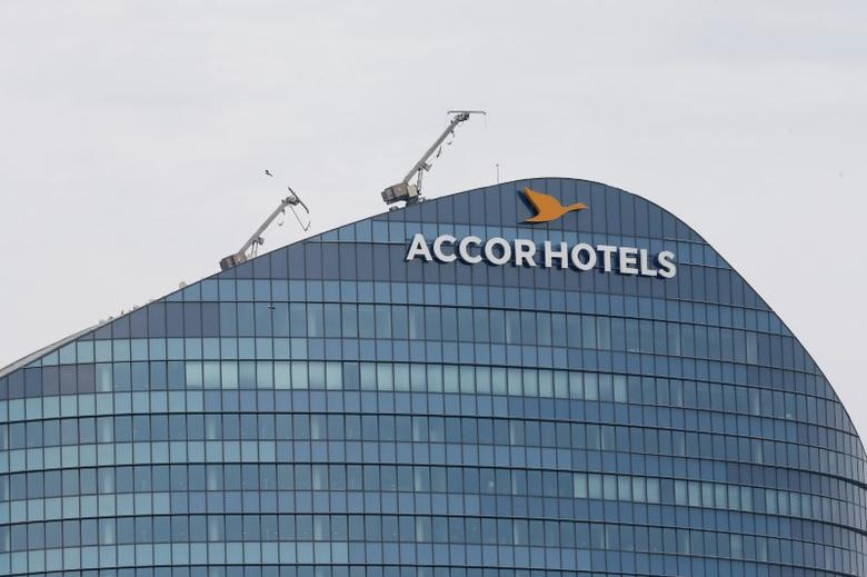 FILE PHOTO: The logo of French hotel operator AccorHotels is seen on top of the building company's headquarters in Issy-les-Moulineaux near Paris, France, April 22, 2016. REUTERS/Gonzalo Fuentes/File Photo