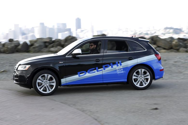 FILE PHOTO: An autonomous car from Delphi departs Treasure Island for a cross-country trip from San Francisco to New York City in San Francisco, California, U.S. on March 22, 2015.  REUTERS/Stephen Lam/File Photo