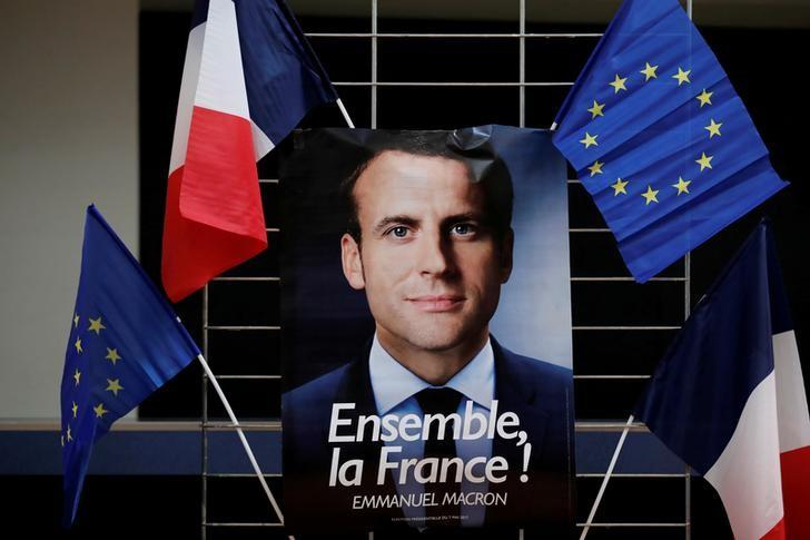FILE PHOTO: An electoral poster of Emmanuel Macron, head of the political movement En Marche !, or Onwards !, and candidate for the 2017 presidential election, is displayed during a campaign rally in Paris, France, May 2, 2017.    REUTERS/Benoit Tessier/File Photo