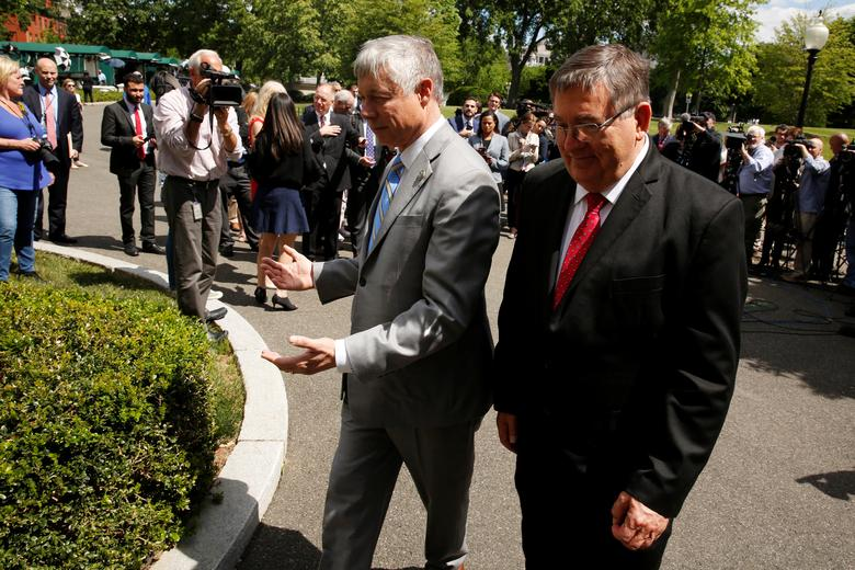 U.S. Representative Fred Upton (R-MI) (C) and Representative Michael Burgess (R-TX) (R) return to the West Wing after speaking to reporters about health care legislation after meeting with President Trump at the White House in Washington, U.S. May 3, 2017.  REUTERS/Jonathan Ernst