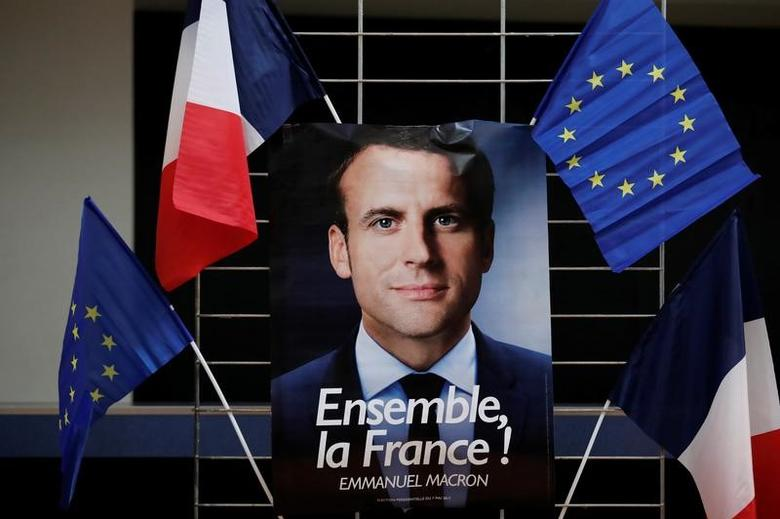 An electoral poster of Emmanuel Macron, head of the political movement En Marche !, or Onwards !, and candidate for the 2017 presidential election, is displayed during a campaign rally in Paris, France, May 2, 2017. REUTERS/Benoit Tessier - RTS14V0U