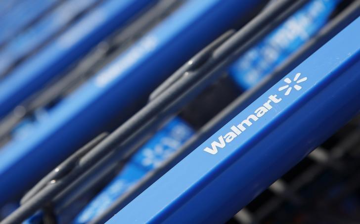 Shopping carts are seen outside a new Wal-Mart Express store in Chicago July 26, 2011. Wal-Mart Stores Inc reporterd a higher-than-expected quarterly profit May 19, 2106, as sales in the U.S. market rose, sending the retailer's shares up nearly 10 percent.   REUTERS/John Gress/Files