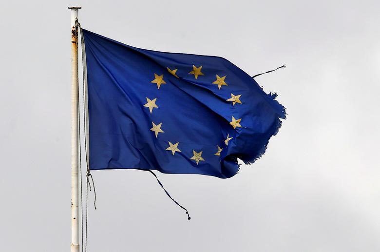 FILE PHOTO: A frayed EU flag flutters atop the Greek Ministry of Finance in central Athens, Greece, February 24, 2015.   REUTERS/Yannis Behrakis/File Photo