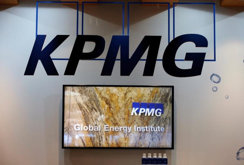 FILE PHOTO: Logos of KPMG are seen in its booth at Gastech, the world's biggest expo for the gas industry, in Chiba, Japan April 4, 2017. REUTERS/Toru Hanai
