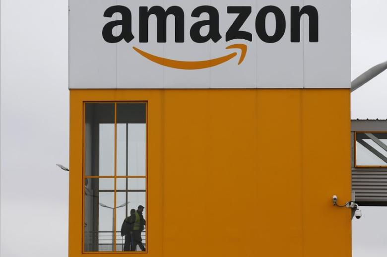 FILE PHOTO: The logo of Amazon is seen at the company logistics center in Lauwin-Planque, northern France, February 20, 2017. REUTERS/Pascal Rossignol