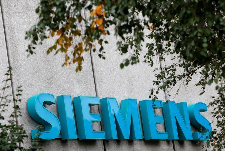 Siemens logo is pictured at Siemens Healthineers headquarters in Erlangen near Nuremberg, Germany, October 7, 2016. REUTERS/Michaela Rehle/Files