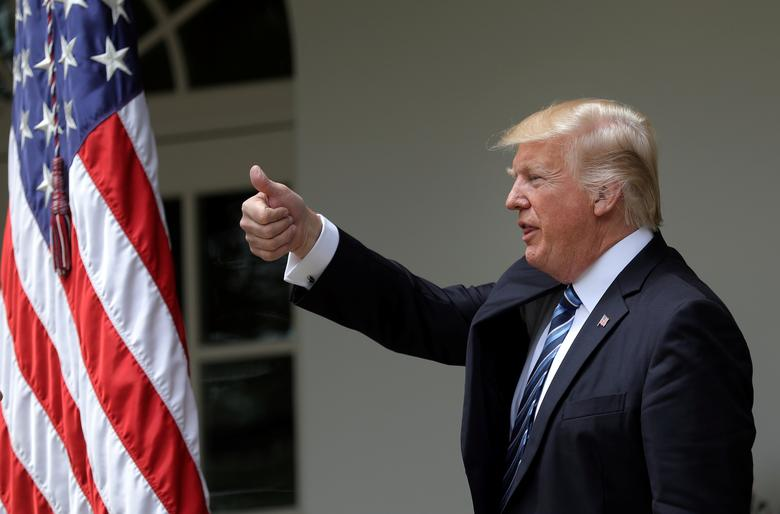 U.S. President Donald Trump gives a thumbs up during a National Day of Prayer event at the Rose Garden of the White House in Washington D.C., U.S., May 4, 2017. REUTERS/Carlos Barria