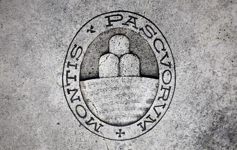 A logo of Monte dei Paschi di Siena bank is seen on the ground in Siena, Italy, November 5, 2014. REUTERS/Giampiero Sposito/Files
