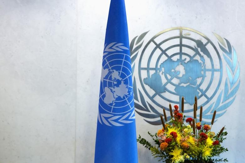 A United Nations logo and flag are seen during the U.N. General Assembly at U.N. Headquarters in New York September 25, 2013. REUTERS/Eric Thayer