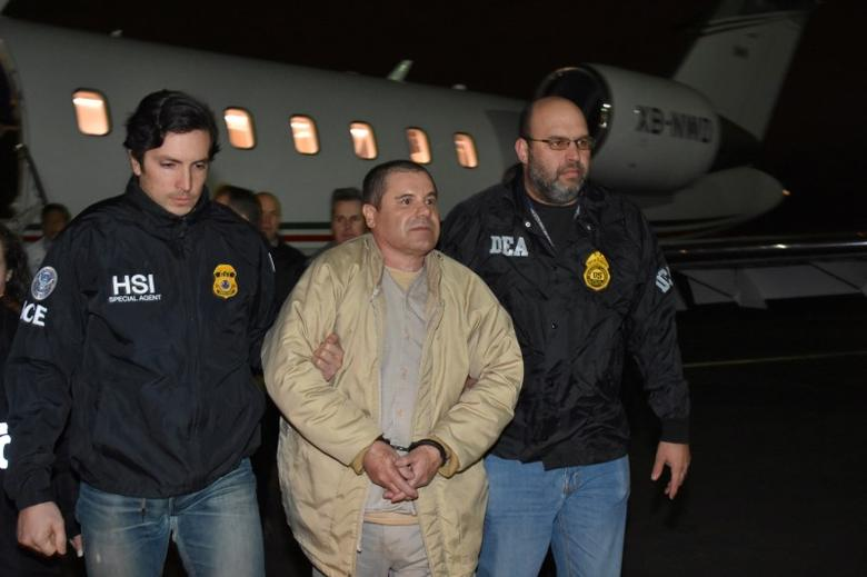 Mexico's top drug lord Joaquin ''El Chapo'' Guzman is escorted as he arrives at Long Island MacArthur airport in New York, U.S., January 19, 2017, after his extradition from Mexico. U.S. officials/Handout via REUTERS