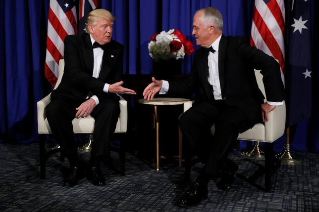 U.S. President Donald Trump (L) and Australia's Prime Minister Malcolm Turnbull (R) meet ahead of an event commemorating the 75th anniversary of the Battle of the Coral Sea, aboard the USS Intrepid Sea, Air and Space Museum in New York, U.S. May 4, 2017. REUTERS/Jonathan Ernst
