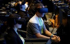 Showgoers wear Oculus Rift virtual reality headsets during the Intel press conference at CES in Las Vegas, January 4, 2017.  REUTERS/Rick Wilking