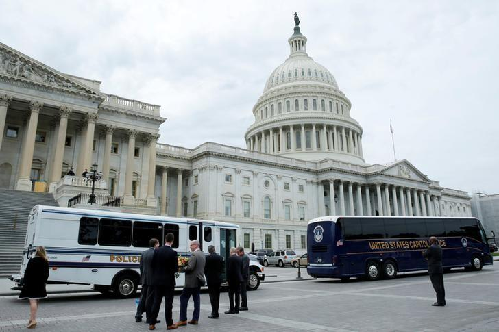 Buses with members of Congress leave Capitol Hill to the White House after the U.S. House approved a bill to repeal major parts of Obamacare and replace it with a Republican healthcare plan in Washington, U.S., May 4, 2017. REUTERS/Yuri Gripas