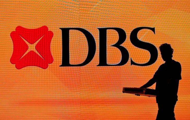 A worker walks past a DBS logo before an event in Mumbai, India, April 26, 2016. REUTERS/Danish Siddiqui/File Photo
