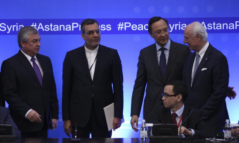 FILE PHOTO: Russian lead negotiator on Syria Alexander Lavrentyev, Iranian Deputy Foreign Minister Hossein Jaberi Ansari, Kazakh Foreign Minister Kairat Abdrakhmanov and U.N. Special Envoy for Syria Staffan de Mistura attend the fourth round of Syria peace talks in Astana, Kazakhstan, May 4, 2017. REUTERS/Mukhtar Kholdorbekov