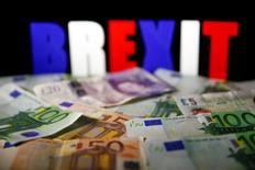 FILE PHOTO: Euro and Pound banknotes are seen in front of BREXIT letters in this picture illustration taken April 28, 2017. REUTERS/Dado Ruvic/Illustration